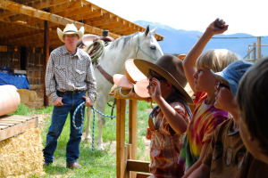 Farmhands learn about horses and leather working at Ranch Camp.