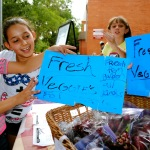 Boys and Girls Club members selling produce at the Youth Farmers Market.